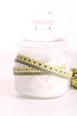 Sugar in a bank surrounded by metric. Sugar is unhealthy concept