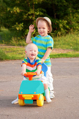 Two brothers, one with Down syndrome, have fun playing.