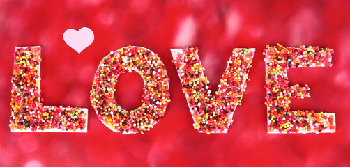 Word Love on red background
