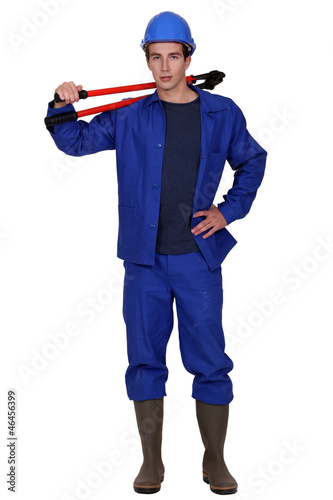 young worker posing with bolt cutters