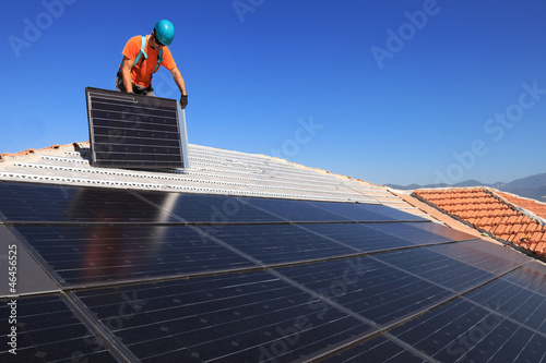 installing alternative energy photovoltaic solar panels