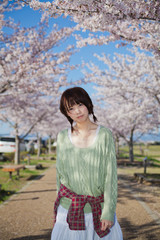A young woman in cherry blossom