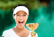 Tennis player won the cup at the sport tournament. Award