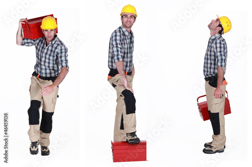 Builder posing with a toolbox