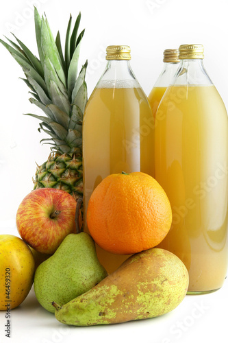 Fruit and bottles of juice