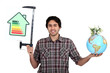 Man holding a globe and an energy efficiency rating chart