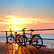 Two bikes on the beach. Sunset. Silhouette .