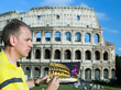 Italy. Rome. The man artist draws the Colosseum...