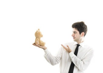 Young businessman with his teddy bear with blank space