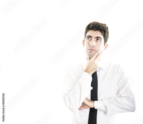 Young doubtful businessman with blank space