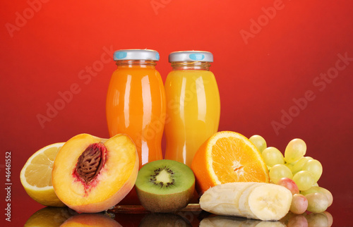 Delicious multifruit juice in a bottle and fruit next to it