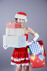 Beautiful asian woman with christmas presents