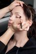 Professional make up artist applying make up to a fashion model/
