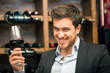 Young man tasting red wine