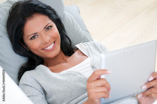 Girl smile with tablet