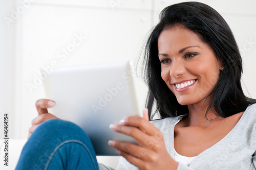 Girl enjoy modern tablet