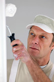 Painter redecorating house