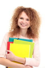 Happy young student girl holding books
