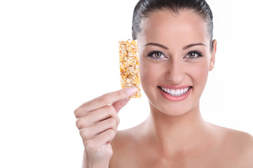 young woman with muesli bar