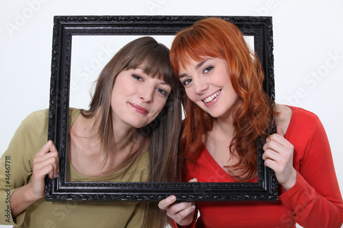 Women posed in a frame