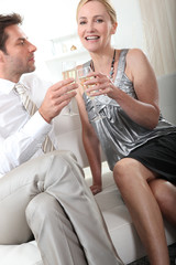 Couple holding champagne glasses