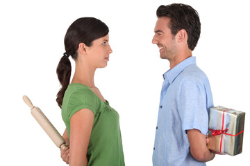 Man apologizing to woman with rolling-ping