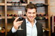 Smiling man tasting red wine