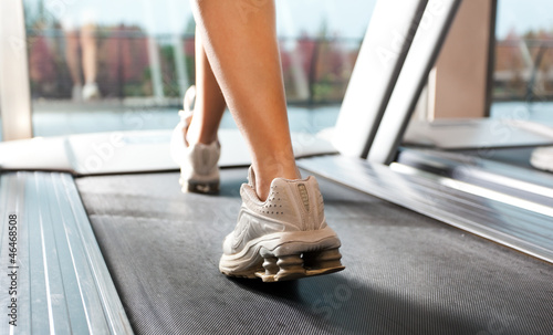 Woman running on treadmills in the gym