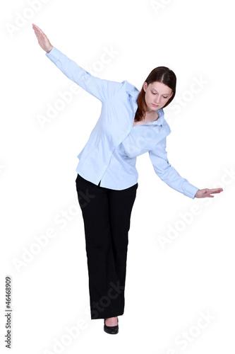 Woman walking an imaginary tightrope