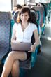 Cheerful businesswoman on the train / bus. Business on the move