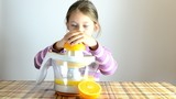 girl making fresh orange juice