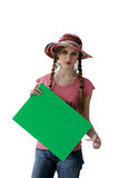 Woman with hat pointing at green poster