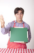 Handsome casual male cook with green board