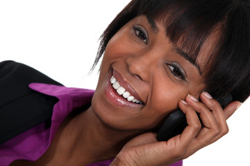 Happy businesswoman using a mobile phone