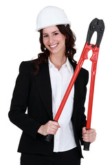 Corporate woman holding pliers.
