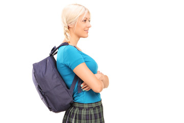 A female student standing in profile