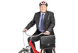 A mature businessman with briefcase on a bicycle