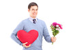 A young man holding flowers and red heart