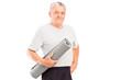 An elderly athlete holding a mat