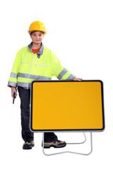 A kid road worker.