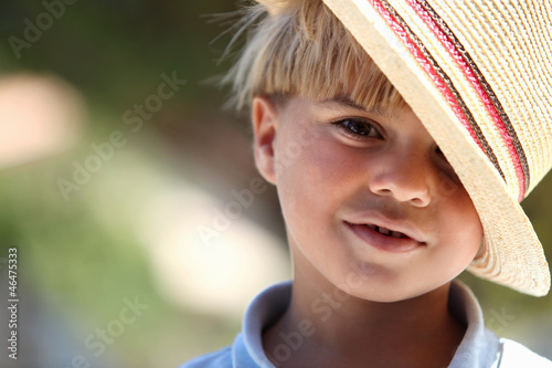 Little boy wearing straw hat