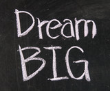 Fototapety Dream big text written on a blackboard