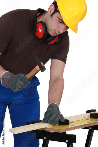 Worker using a hammer