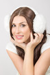 Beautiful young woman wearing white earmuffs