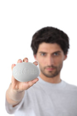Man holding a bar of soap