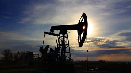 working oil pump at sunset