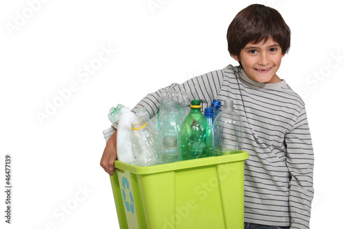 child all smiles holding recycling bin