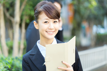 Young asian smiling businesswoman and businessman