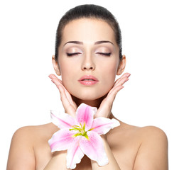 Beauty face of pretty woman with flower. Beauty treatment concep