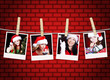 photos of christmas girls hanging on clothesline with brick wall